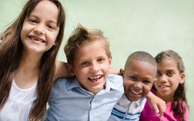 happy children hugging, smiling and having fun